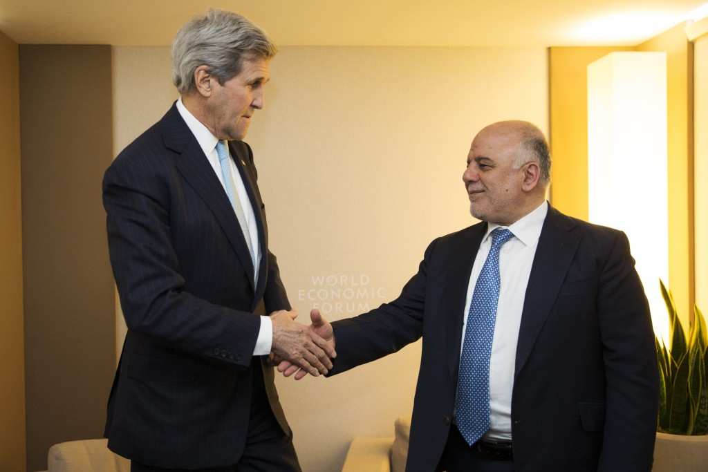 U.S. Secretary of State John Kerry, left, meets with Iraqi Prime Minister Haider al-Abadi at the 2016 World Economic Forum in Davos, Switzerland, on Thursday, Jan. 21, 2016. Kerry's trip is expected to last nine days and to encompass stops in Switzerland, Saudi Arabia, Laos, Cambodia, and China. (AP Photo/Jacquelyn Martin, Pool)