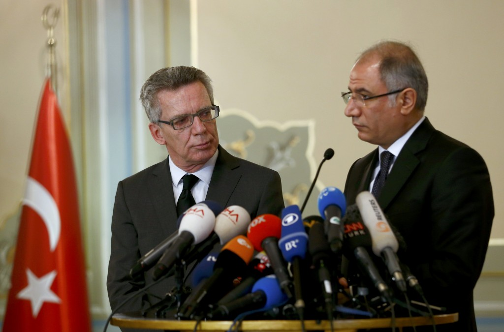 Turkish Interior Minister Efkan Ala (R) and his German counterpart Thomas De Maiziere address a joint news confernence in Istanbul, Turkey January 13, 2016. Turkish authorities detained three Russian nationals suspected of links with Islamic State following a suicide bomb attack in Istanbul that killed 10 tourists, media reports said on Wednesday. A suicide bomber thought to have crossed recently from Syria killed nine German and one Peruvian tourists on Tuesday in Istanbul's historic Sultanahmet Square, a major tourist draw, in an attack Turkey blamed on Islamic State. Fifteen people were also hurt in the attack. REUTERS/Murad SezerTPX IMAGES OF THE DAY