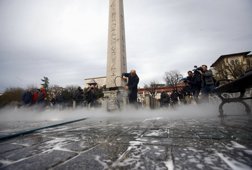 A municipality worker cleans the site of Tuesday's suicide bomb attack at Sultanahmet square in Istanbul, Turkey January 13, 2016. REUTERS/Osman Orsal