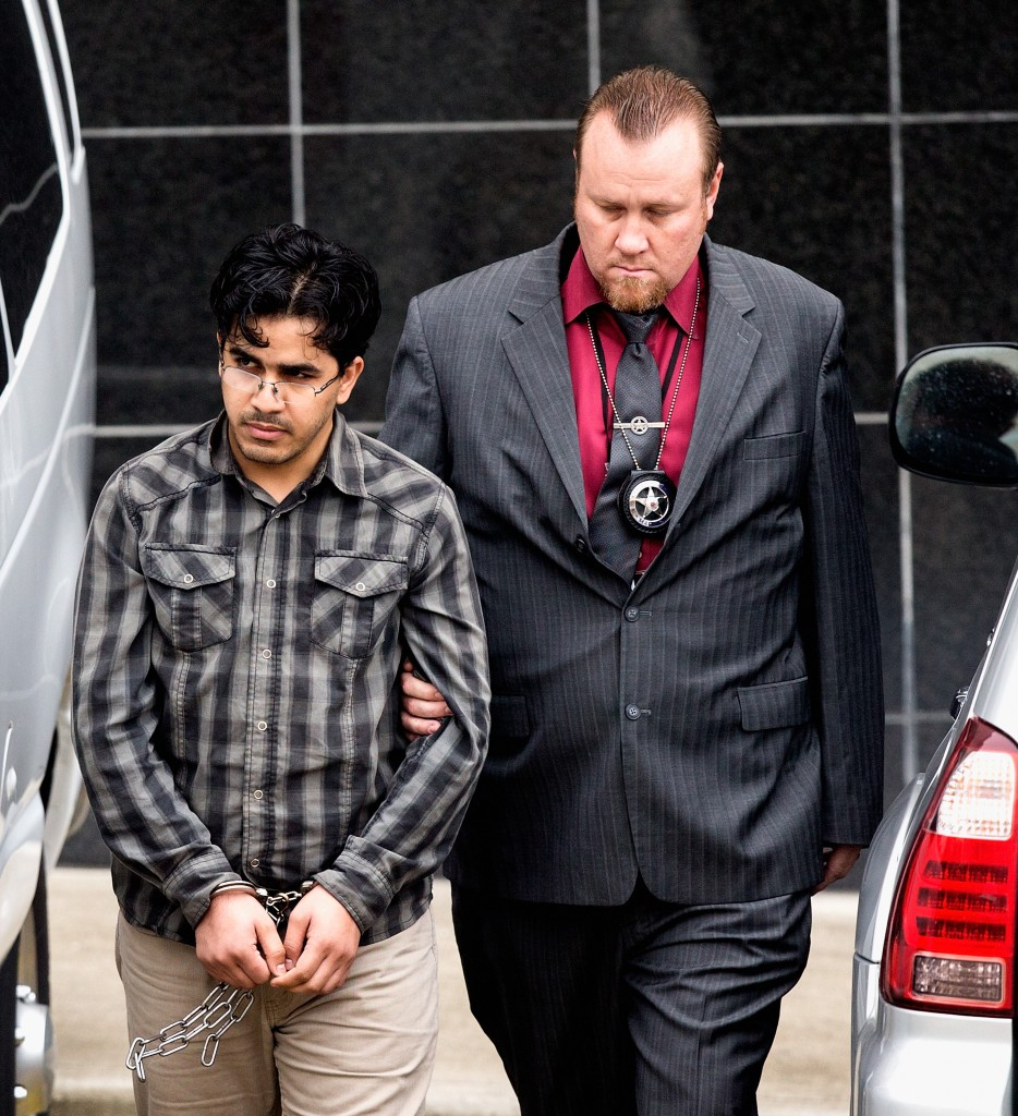 File - In this Jan. 8, 2016 file photo, Omar Faraj Saeed Al Hardan, left, is escorted by U.S. Marshals from the Bob Casey Federal Courthouse, in Houston. Al Hardan, who came to Houston from Iraq in 2009 is set to be arraigned Wednesday, Jan. 13, 2015, and have a bond hearing after his arrest on charges he tried to help the Islamic State group. (AP Photo/Bob Levey, File)