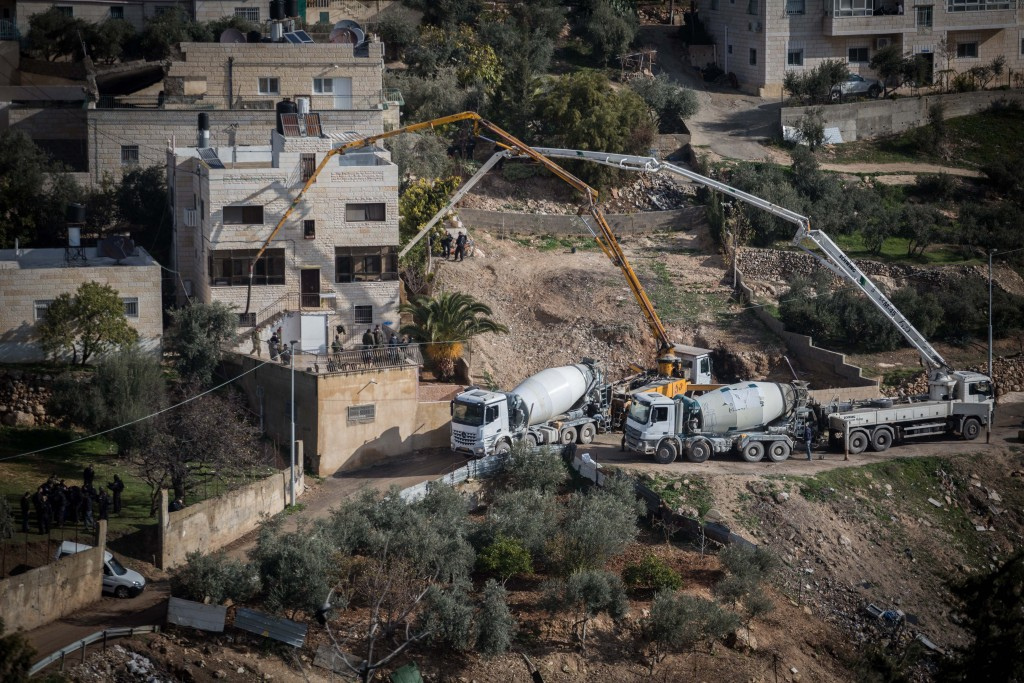 Israeli security forces demolish two terrorists' houses in the eastern Yerushalayim neighborhood of Jabel Mukabar on Monday. (Hadas Parush/Flash90)