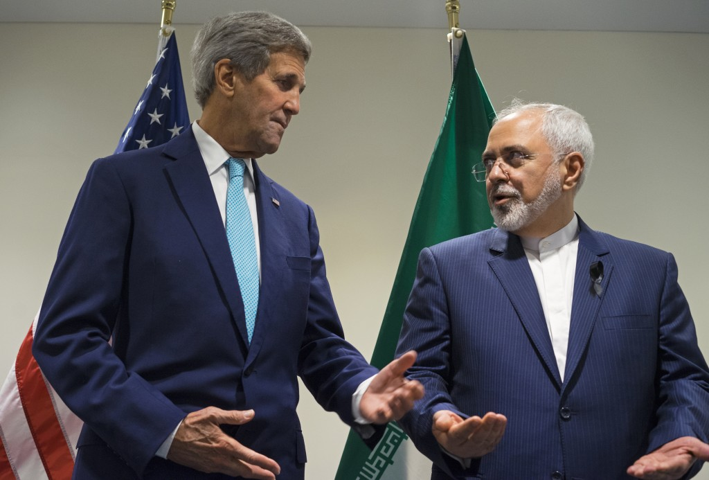 FILE - In this Sept. 26, 2015 file photo, Secretary of State John Kerry meets with Iranian Foreign Minister Mohammad Javad Zarif at United Nations headquarters. (AP Photo/Craig Ruttle, File)