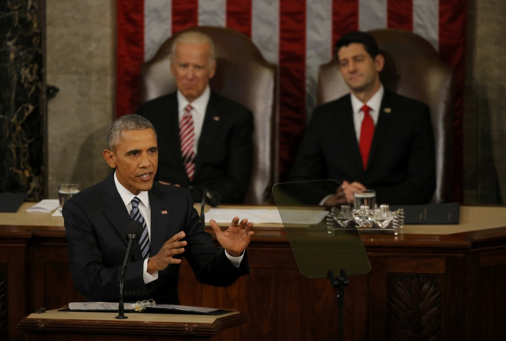 U.S. Vice President Joe Biden (L, rear) and Speaker of the House Paul Ryan (R, rear) look on as U.S. President Barack Obama delivers his State of the Union address to a joint session of Congress in Washington, January 12, 2016. REUTERS/Carlos Barria
