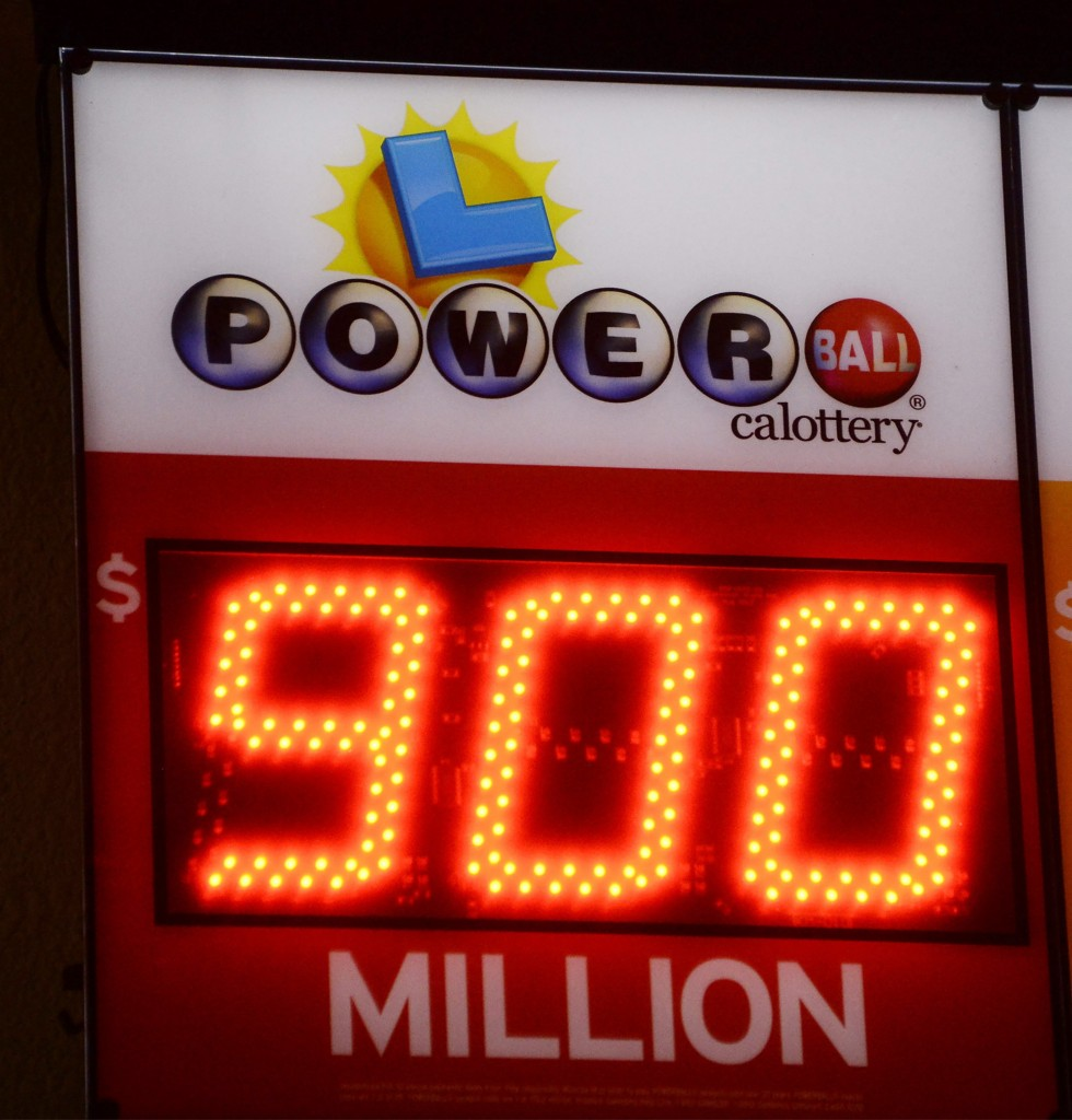 A sign shows the estimated jackpot for this Saturday's Powerball lottery at the CA lotto store in San Bernardino County, California, on the California-Nevada state line January 9, 2016. Millions of Americans anxiously awaited Saturday night's drawing in the multi-state Powerball lottery hoping to win a jackpot that has climbed to a record $900 million and could top $1 billion before the frenzy to buy tickets ends, officials said. California, the nation's most populous state, normally sees Powerball sales of $1 million a day, but on Saturday morning sales were a head-spinning $2.8 million an hour, said California Lottery spokesman Mike Bond. REUTERS/Gene Blevins