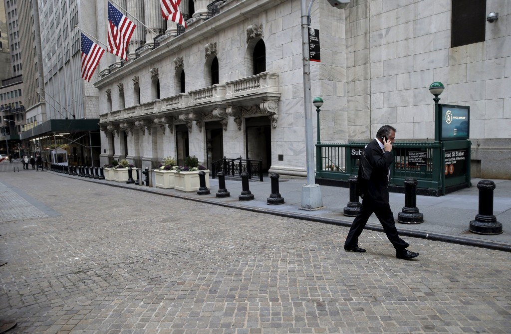 A trader talks on the phone as he walks outside the New York Stock Exchange before the opening bell of the trading session in the Manhattan borough of New York City, January 7, 2016. Wall Street was set to open sharply lower for a second straight day on Thursday after China allowed the yuan to fall further and oil prices slid to near 12-year lows, raising concerns over the state of the global economy. REUTERS/Brendan McDermid