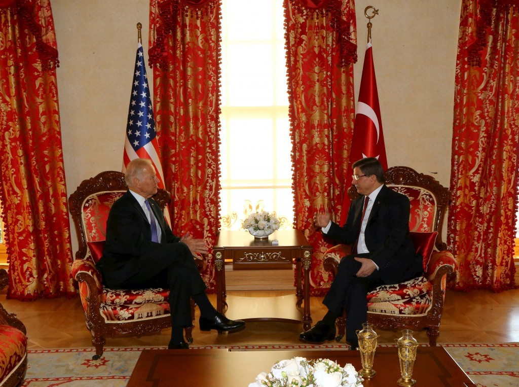 U.S. Vice President Joe Biden (L) meets with Turkish Prime Minister Ahmet Davutoglu in Istanbul, Turkey January 23, 2016 in this handout photo provided by the Prime Minister's Press Office. REUTERS/Hakan Goktepe/Prime Minister's Press Office/Handout via Reuters ATTENTION EDITORS - THIS IMAGE WAS PROVIDED BY A THIRD PARTY. REUTERS IS UNABLE TO INDEPENDENTLY VERIFY THE AUTHENTICITY, CONTENT, LOCATION OR DATE OF THIS IMAGE. IT IS DISTRIBUTED EXACTLY AS RECEIVED BY REUTERS, AS A SERVICE TO CLIENTS. FOR EDITORIAL USE ONLY. NOT FOR SALE FOR MARKETING OR ADVERTISING CAMPAIGNS. NO RESALES. NO ARCHIVE.