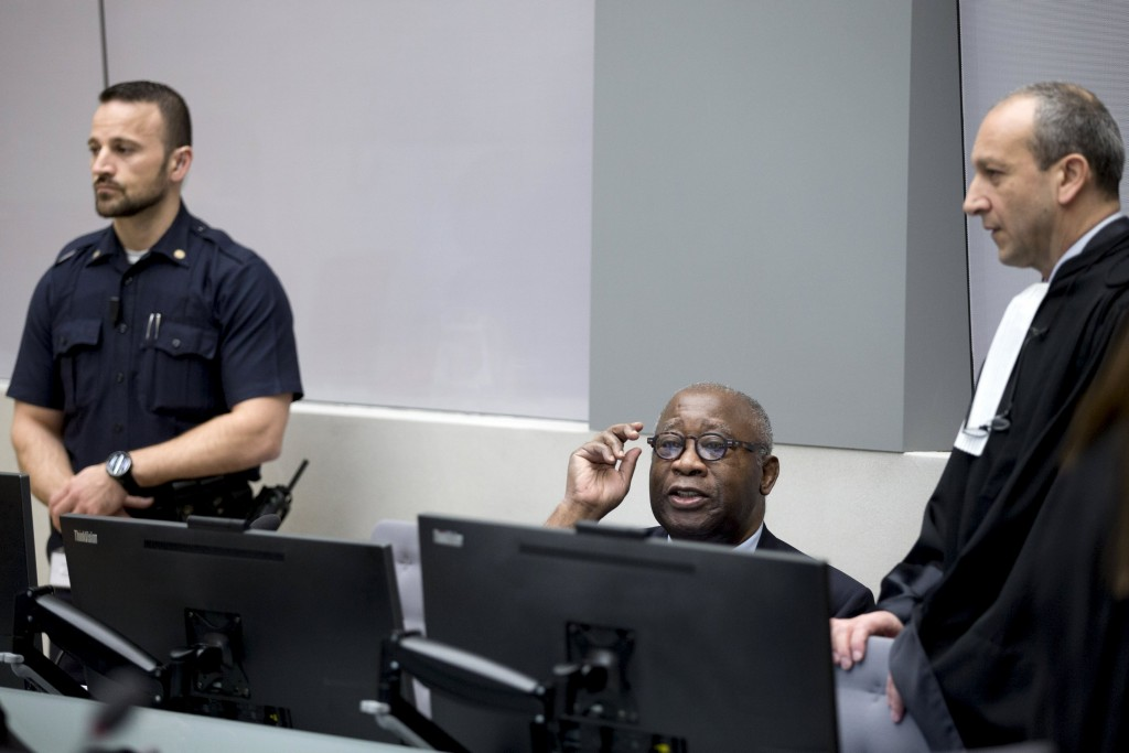 """Former Ivory Coast President Laurent Gbagbo (C) and his lawyer Emmanuel Altit (R) wait for the start of the trial at the International Criminal Court in The Hague, Netherlands, January 28, 2016. The International Criminal Court's prosecutor vowed on Wednesday to """"leave no stone unturned"""" in investigating alleged crimes committed by all sides in Ivory Coast's brief 2010 civil war, including by supporters of President Alassane Ouattara. Prosecutor Fatou Bensouda was speaking a day before Ivory Coast's former president Laurent Gbagbo was due to go on trial in The Hague on charges of unleashing the civil war, in which 3,000 people died, after refusing to accept his election defeat. REUTERS/Peter Dejong/Pool"""