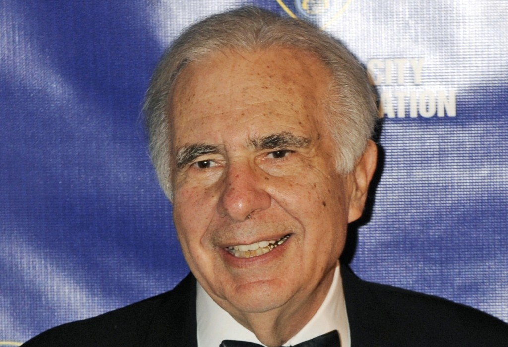 FILE - In this March 16, 2010, file photo, financier Carl Icahn poses for photos upon arriving for the 32nd annual New York City Police Foundation Gala in New York. (AP Photo/Henny Ray Abrams, File)