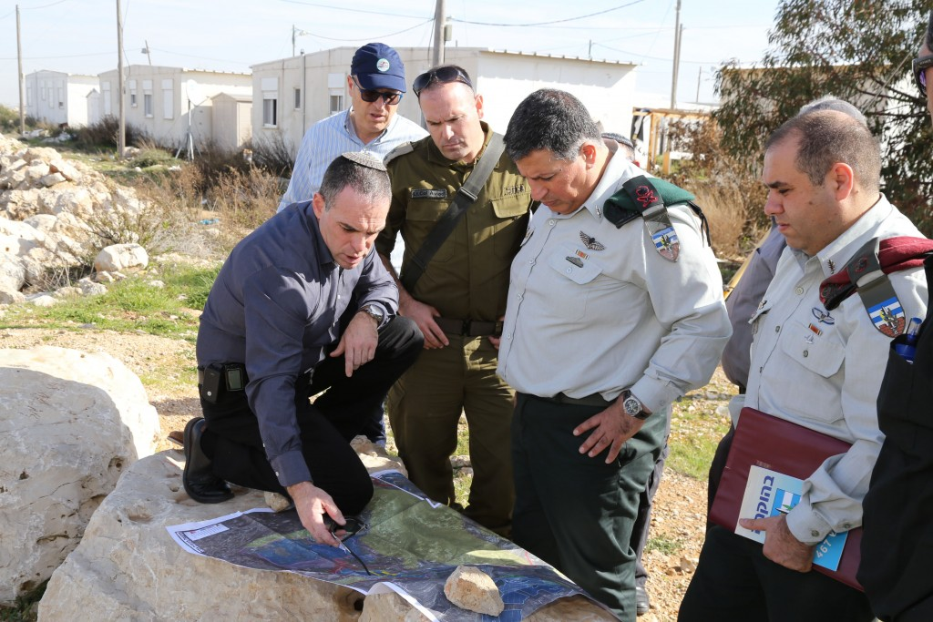 Government Coordinator in the Territories Brigadier general Yoav Mordechai (2R) speaks with Oded Ravivi (L), head council of Efrat, during a tour expanding the settlement of Efrat in Gush Etzion on January 25, 2015. Photo by Gershon Elinson/Flash90