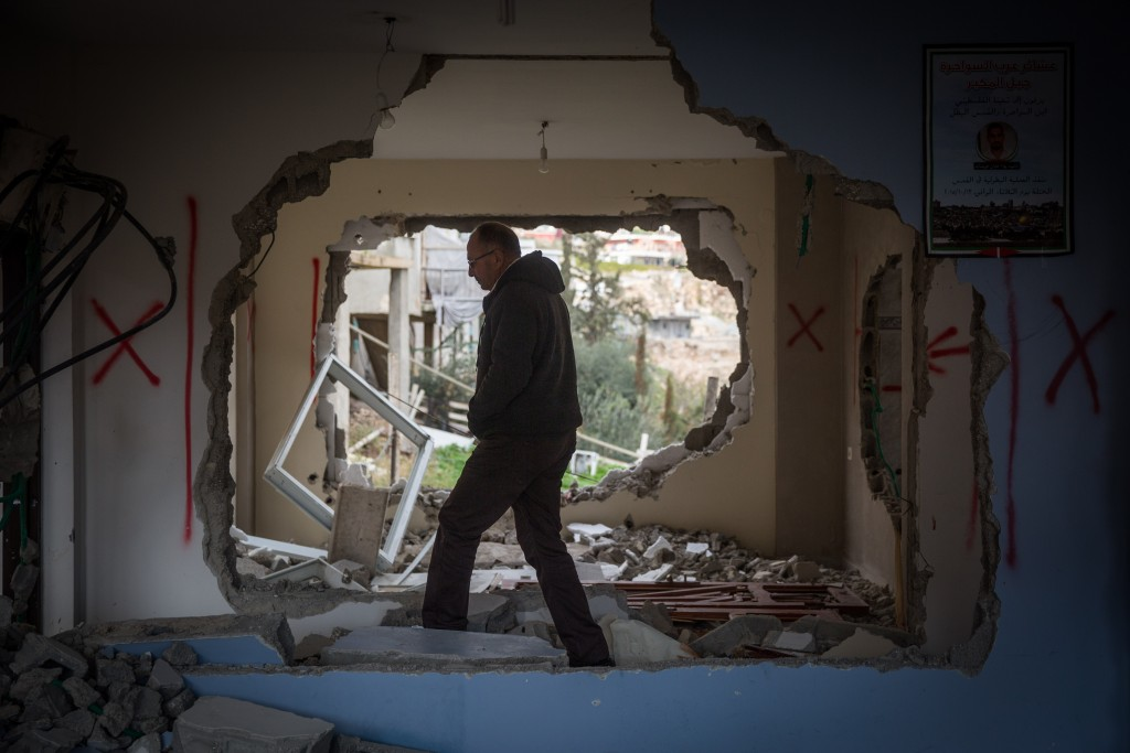 A man inspects the demolished home of an Arab terrorist in Jabel Mukabar. Photo by Hadas Parush/Flash90