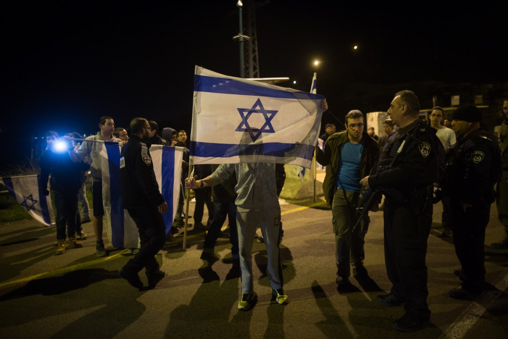 Residents of the Hevron Hills protest following the terror attack in Otniel. Photo by Yonatan Sindel/Flash90