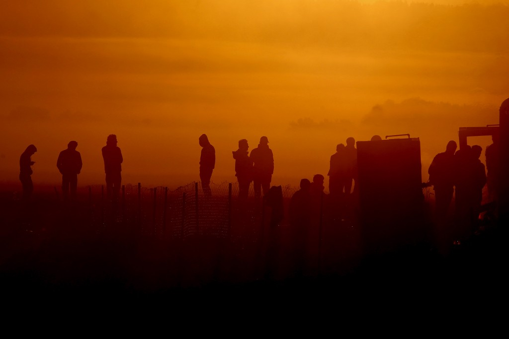 Refugees and migrants are silhouetted as they wait to cross Greece's border with Macedonia near the Greek village of Idomeni, October 27, 2015. According to United Nations over half a million refugees and migrants have arrived by sea in Greece this year and the rate of arrivals is rising, in a rush to beat the onset of freezing winter. REUTERS/Alexandros Avramidis TPX IMAGES OF THE DAY (Newscom TagID: rtrlseven410250.jpg) [Photo via Newscom]