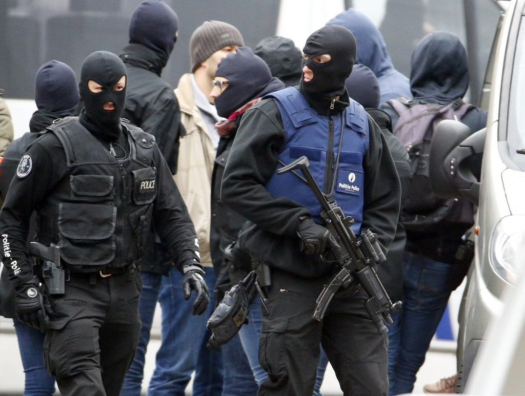 Belgian police stage a raid, in search of suspected muslim fundamentalists linked to the deadly attacks in Paris, in the Brussels suburb of Molenbeek, November 16. 2015. REUTERS/Yves Herman (Newscom TagID: rtrlseven456830.jpg) [Photo via Newscom]
