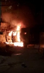 The burning IDF jeep in Kalandiya.