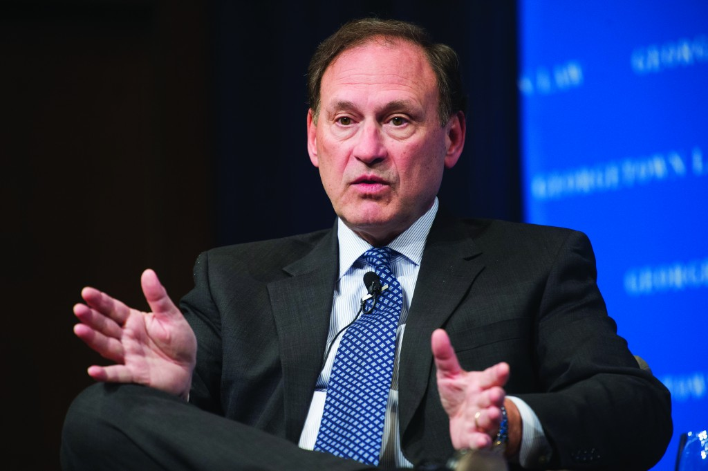 Supreme Court Justice Samuel Alito gestures while speaking at Georgetown University Law Center's third annual Dean's Lecture to the Graduation Class, in Washington. (AP Photo/Cliff Owen)