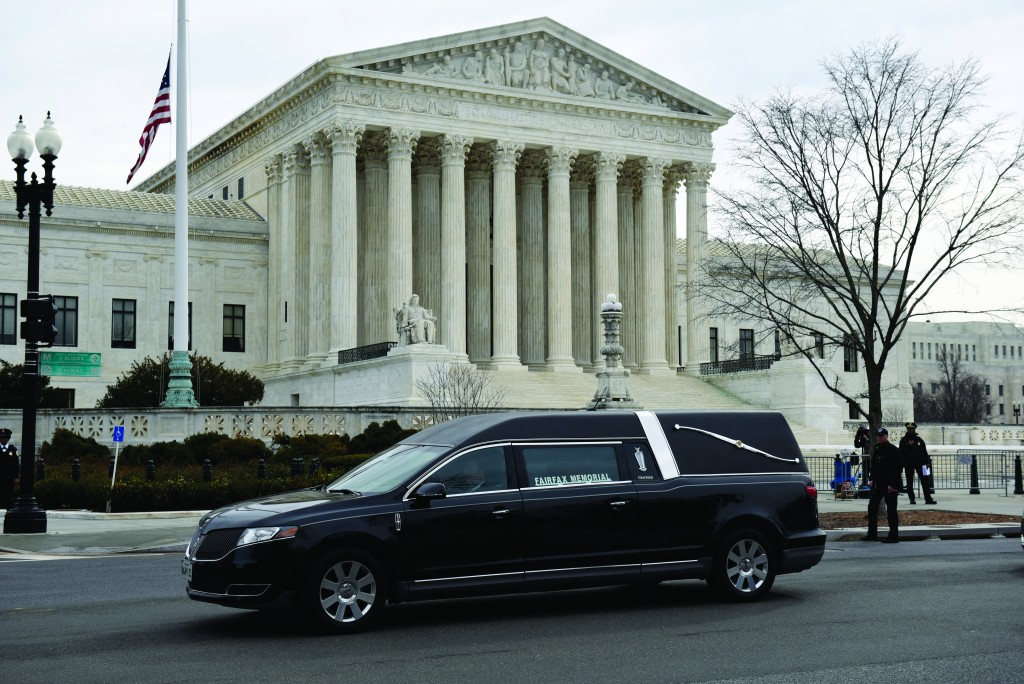 A hearse carrying the casket of the late Supreme Court Associate Justice Antonin Scalia, departs the Supreme Court on Saturday, Feb. 20, 2016, in Washington. (AP Photo/Sait Serkan Gurbuz)