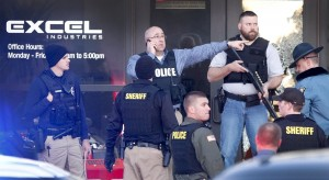 Police guard the front door of Excel Industries in Hesston, Kan., after the shootings on Thursday. (Fernando Salazar/The Wichita Eagle via AP)