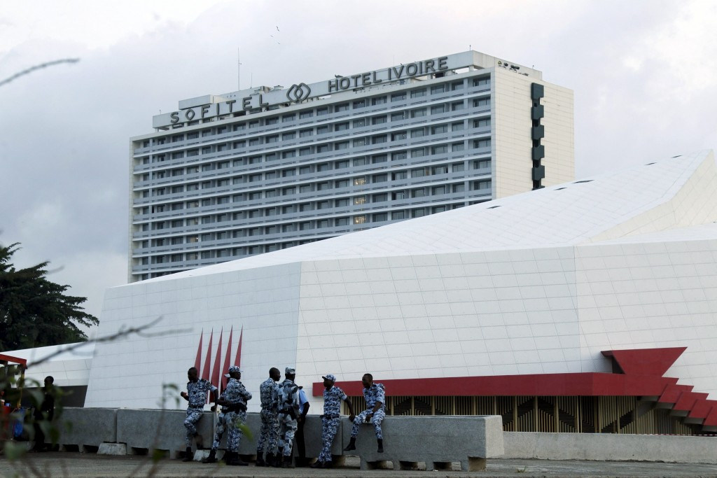 Ivorian security forces gather as they guard the Sofitel Abidjan Hotel Ivoire in Abidjan January 20, 2016. West African hotels from Dakar to N'Djamena are strengthening security, adding armed guards and increasing cooperation with local authorities as a pair of high-profile attacks have exposed a growing Islamist threat to foreign travellers. Picture taken on January 20, 2016. REUTERS/Luc Gnago