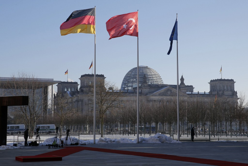 German and Turkish flags flutter outside the Chancellery in Berlin, Germany, January 22, 2016. (Fabrizio Bensch/Reuters)
