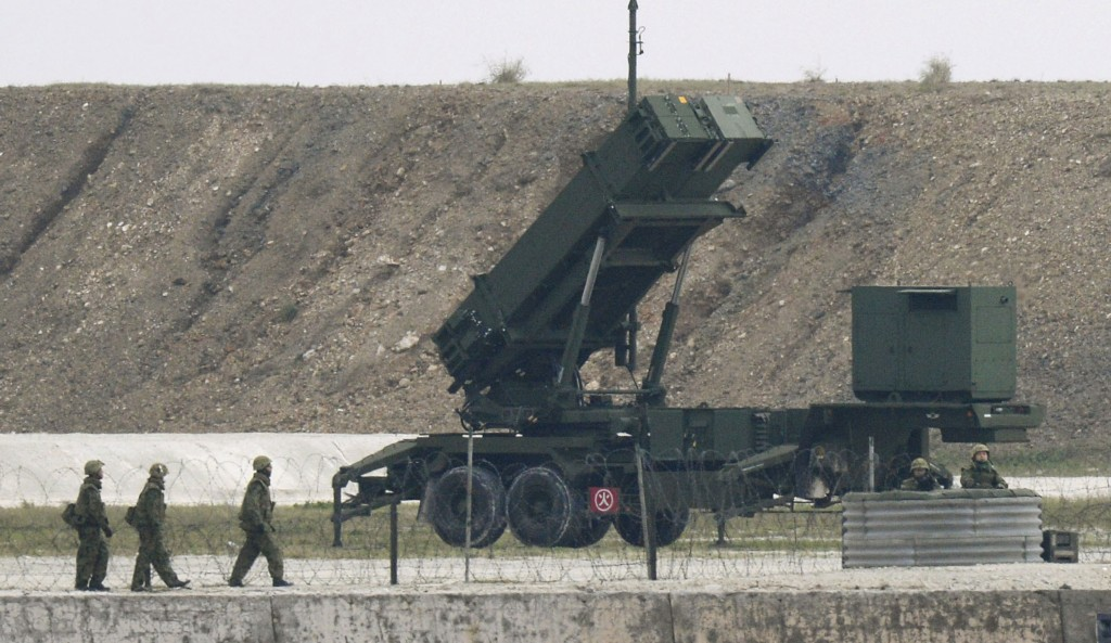 Japanese Self-Defence Force's soldiers are seen next to the unit of Patriot Advanced Capability-3 (PAC-3) missiles in the Japanese southern island of Ishigaki, Okinawa prefecture, in this photo taken by Kyodo February 7, 2016. (Kyodo/Reuters)