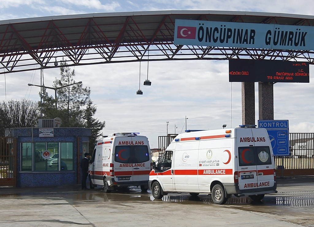 Ambulances enter Syria from Turkey at Turkey's Oncupinar border crossing in the southeastern city of Kilis, Turkey, on Sunday. (Reuters/Osman Orsal)