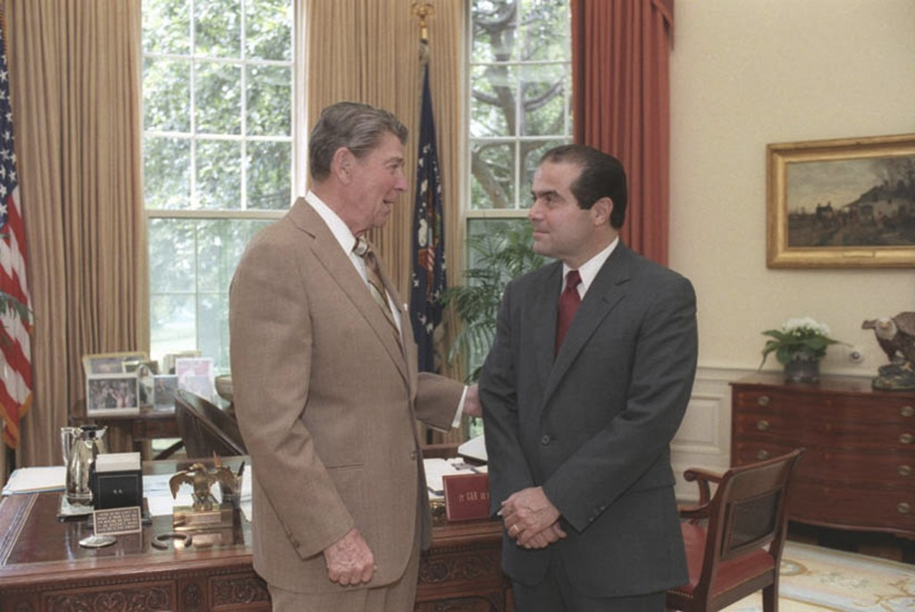 U.S. President Ronald Reagan speaks with Supreme Court Justice nominee Antonin Scalia (R) in the White House Oval Office in Washington, DC in a July 7, 1986 file photo courtesy of the Ronald Reagan Library. (Bill Fitz-Patrick/White House/Courtesy Ronald Reagan Library/Handout via Reuters)