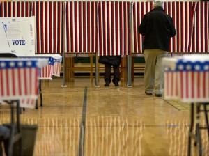 People cast their votes in the presidential primary at Windham High School in Windham, N.H., on Tuesday. (AP Photo/Jacquelyn Martin)