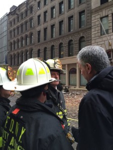 New York City Mayor Bill de Blasio speaks with firefighters at the scene of Sunday morning's fatal crane collapse in Lower Manhattan. (FDNY)