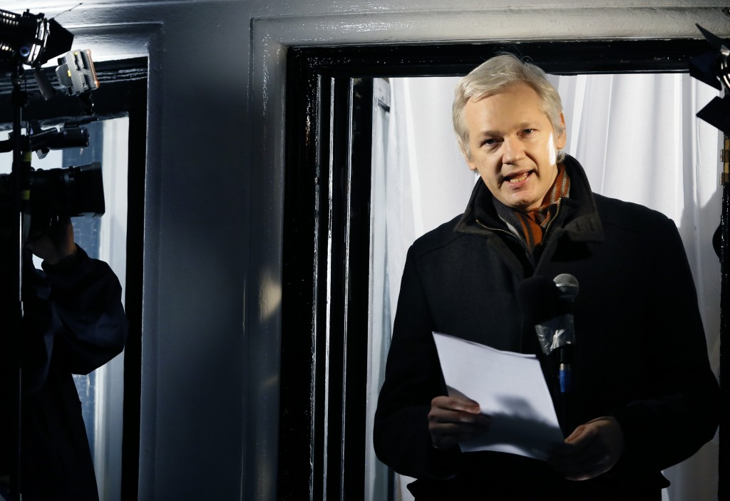 In this Dec. 20, 2012 photo, Julian Assange, founder of WikiLeaks, speaks to the media and members of the public from a balcony at the Ecuadorian Embassy in London. (AP Photo/Kirsty Wigglesworth, File)