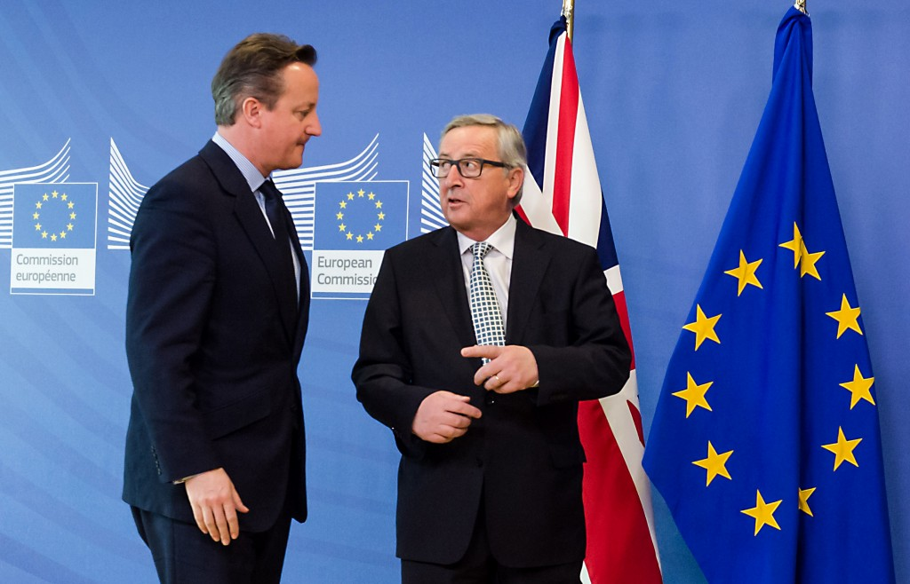 British Prime Minister David Cameron, left, is greeted by European Commission President Jean-Claude Juncker at EU headquarters in Brussels on Tuesday, Feb. 16, 2016. David Cameron is visiting EU leaders two days ahead of a crucial EU summit. (AP Photo/Geert Vanden Wijngaert)