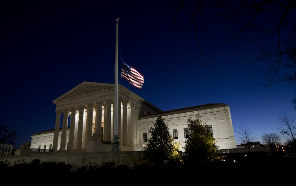 An American flag flies at half-staff in front of the U.S. Supreme Court building in honor of the late Justice Antonin Scalia. (AP Photo/Manuel Balce Ceneta)