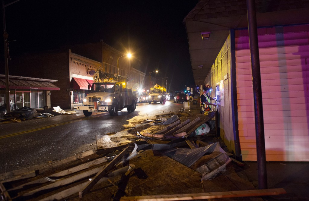 Utility trucks make their way down West Main street in the Town of Waverly, Va.,, after it was hit by a tornado earlier in the day, Wednesday, Feb. 24, 2016. (L. Todd Spencer/The Virginian-Pilot via AP) MAGS OUT