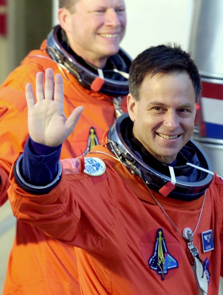 STS-107 Payload Specialist Ilan Ramon waves as he leaves the Operations and Checkout Building with his fellow crew members on Jan. 16, 2003. Behind Ramon is Mission Specialist Dave Brown. (AP Photo/Chris O'Meara)