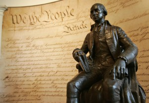 A statue of former President James Madison is shown in front of a mural of the Constitution in the education center at Montpelier, Madison's home, in Orange, Va. (AP Photo/Steve Helber)