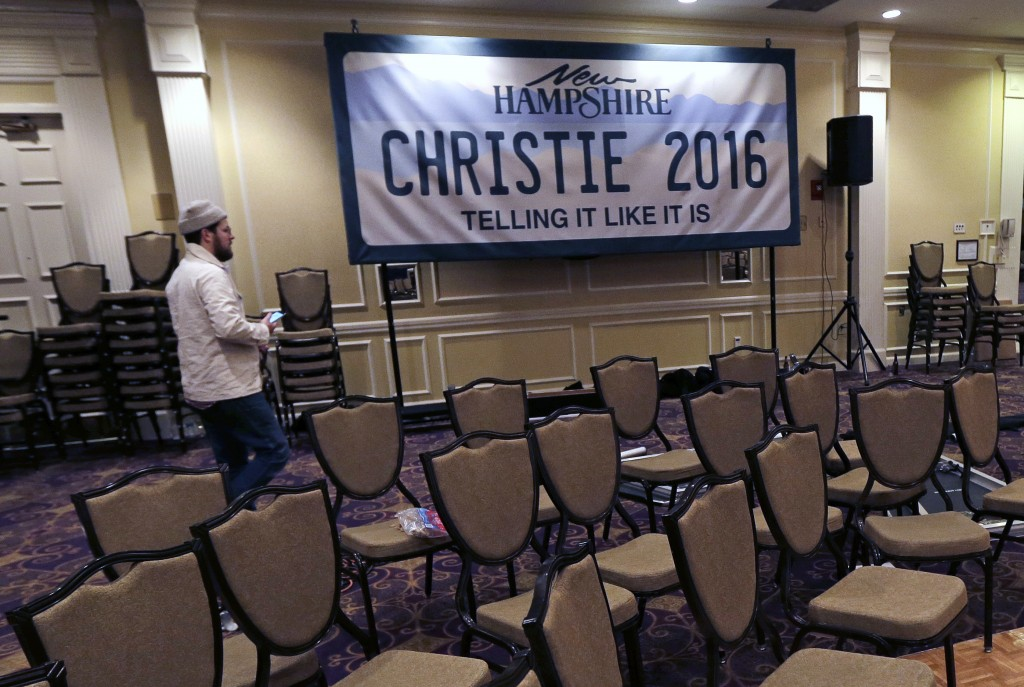 A Christie campaign worker breaks down the primary night rally stage for Chris Christie in Nashua, N.H., on Wednesday. (AP Photo/Charles Krupa)