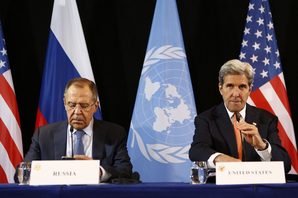 Secretary of State John Kerry (R) and Russian Foreign Minister Sergey Lavrov arrive for a news conference after the International Syria Support Group (ISSG) meeting in Munich, Germany, Friday. (AP Photo/Matthias Schrader)