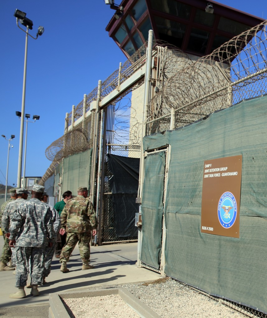 In this Feb. 2, 2016 photo, military personnel enter Camp 6 at the U.S. detention center at Guantanamo Bay, Cuba. After 14 years, the detention center appears to be winding down despite opposition in Congress to President Barack Obama's intent to close the facility and confine the remaining prisoners someplace else. (AP Photo/Ben Fox)