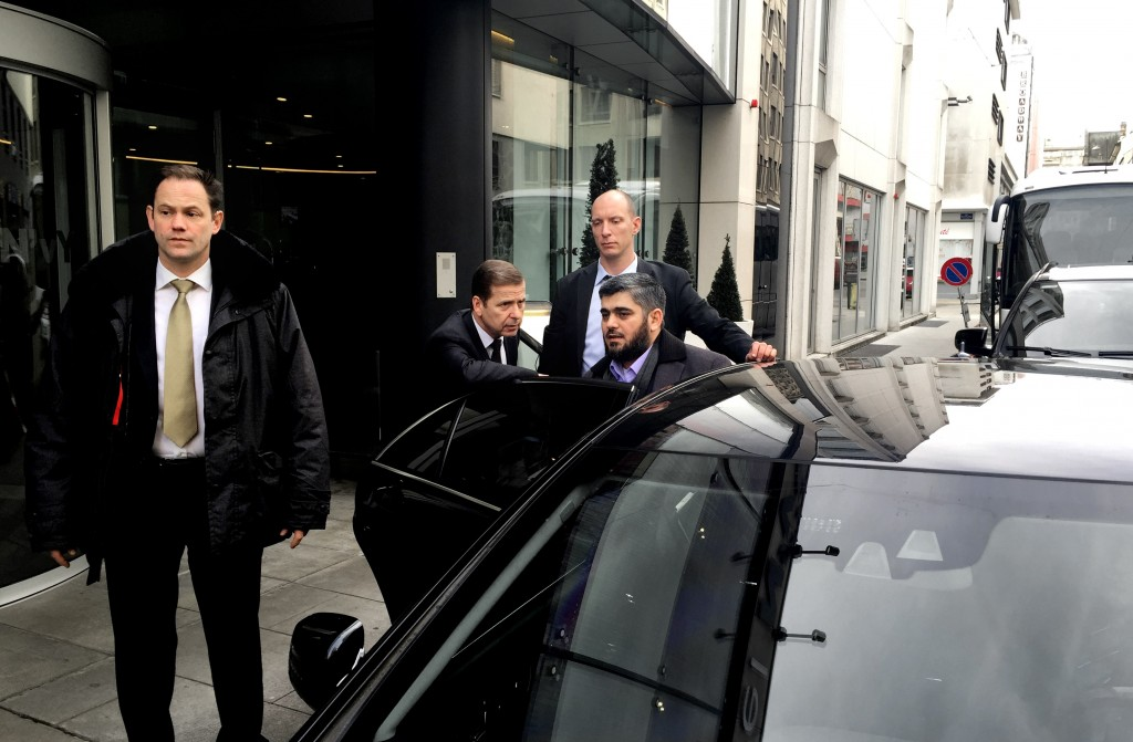 Army of Islam official Mohammed Alloush gets into a car heading to a meeting with the opposition's High Negotiations Committee, in Geneva, Switzerland, Tuesday. Ahrar al-Sham and the Army of Islam, two Islamic groups fighting to overthrow Assad, agreed to take part in the Geneva talks. The ultraconservative Ahrar al-Sham is not part of the team sent to Geneva, but the delegation has named Alloush as its chief negotiator. (AP Photo/Bassem Mroue)