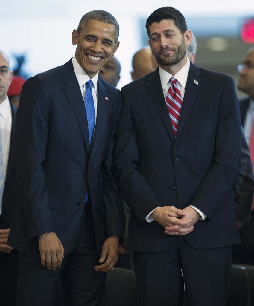 President Barack Obama standing with House Speaker Paul Ryan in Emancipation Hall on Capitol Hill on Dec. 9, 2015, during an event to celebrate the 150th anniversary of the 13th amendment, which abolished slavery. (AP Photo/Evan Vucci)