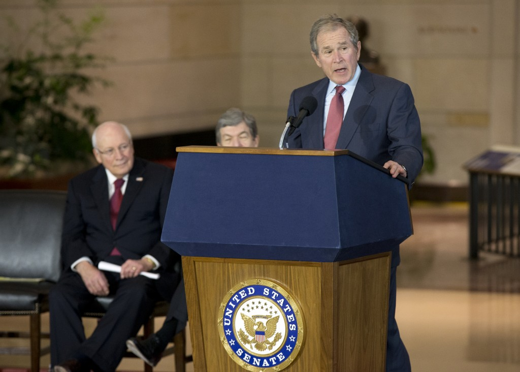 Former President George W. Bush, shown here speaking at the unveiling of the marble bust of former Vice President Dick Cheney, (left) in the Emancipation Hall at the U.S. Capitol on Dec. 3, 2015.  (AP Photo/Manuel Balce Ceneta)
