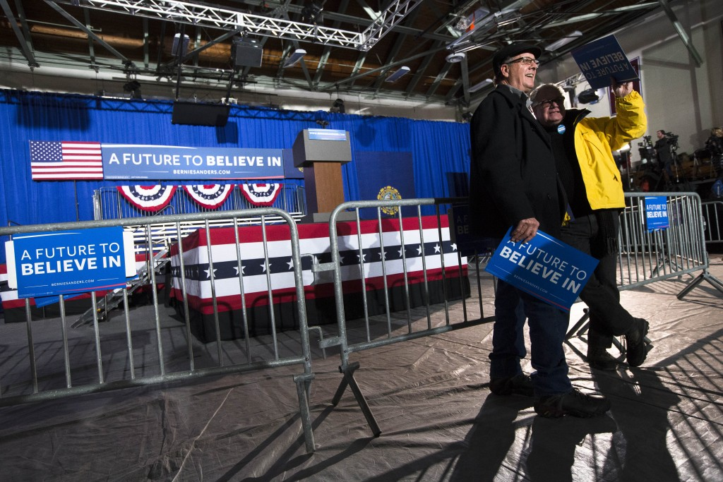 Attendees wait for the arrival of Democratic presidential candidate Sen. Bernie Sanders, I-Vt., ahead of a primary night watch party at Concord High School, Tuesday, Feb. 9, 2016, in Concord, N.H. (AP Photo/John Minchillo)