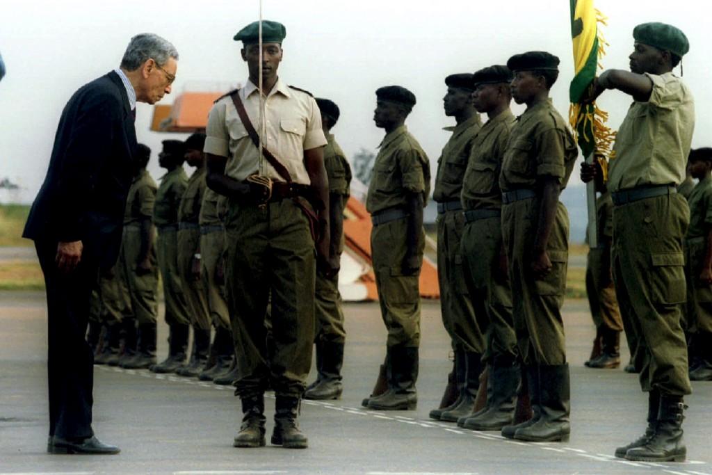United Nations Secretary-General Boutros Boutros-Ghali (L) bows before inspecting a Rwandan military guard of honor in Rwanda, in this July 13, 1995 file picture. Former U.N. Secretary-General Boutros Boutros-Ghali has died, Venezuelan U.N. Ambassador Rafael Dario Ramirez Carreno, president of the U.N. Security Council for February, said on February 16, 2016. He was 93. REUTERS/Corinne Dufka/Files