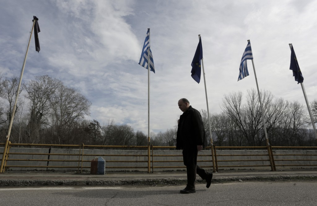 A man approaches the border crossing on foot near Kulata, Bulgaria, to cross into Greece, Thursday, Feb. 18, 2016. Some thousands of vehicles are stuck on both sides of border crossings between Bulgaria and Greece on Thursday due to road blockades by protesting Greek farmers and counter-protests by angry Bulgarian truck drivers. (AP Photo/ Valentina Petrova)