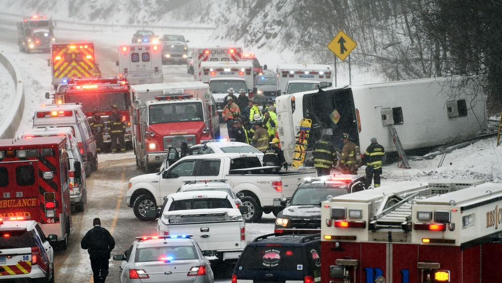 Emergency responders at the scene of a tour-bus rollover on I-95 northbound in the area of exit 61 in Madison, Conn., on Monday. (Sean D. Elliot/The Day via AP)