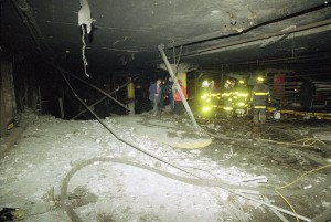 Firefighters and officials examine the World Trade Center's underground parking garage after the massive explosion on Feb. 26, 1993. (AP Photo/Joe Tabacca)