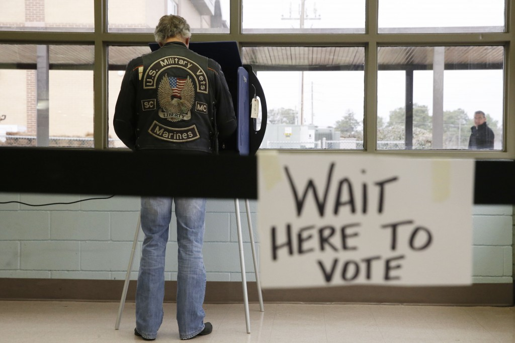A South Carolina voter cast his ballot to vote in the Republican presidential primary Saturday, Feb. 20, 2016, in Lexington, S.C. (AP Photo/Matt Rourke)