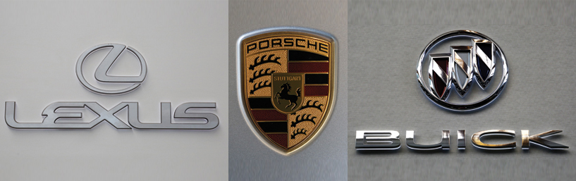 This composite photo shows the logos of Lexus, Porsche and Buick. (AP Photo/Gene J. Puskar)