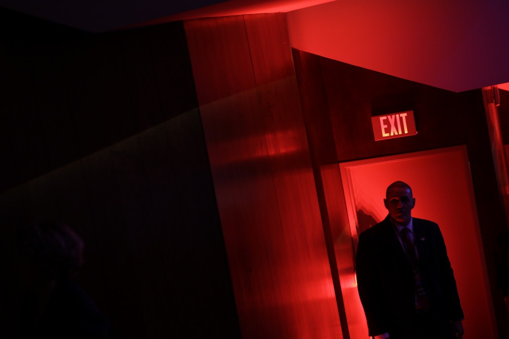A secret service agent stands in the doorway during a Democratic presidential primary debate between Democratic presidential candidate, Hillary Clinton and Democratic presidential candidate, Sen. Bernie Sanders, I-Vt, hosted by MSNBC at the University of New Hampshire Thursday, Feb. 4, 2016, in Durham, N.H. (AP Photo/David Goldman)