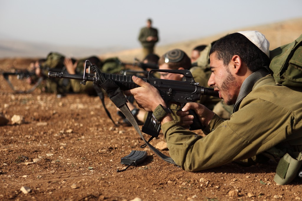 Israeli soldiers seen during a shooting exercise at the Peles Military Base in the Northern Jordan Valley. (Yaakov Naumi/Flash90)