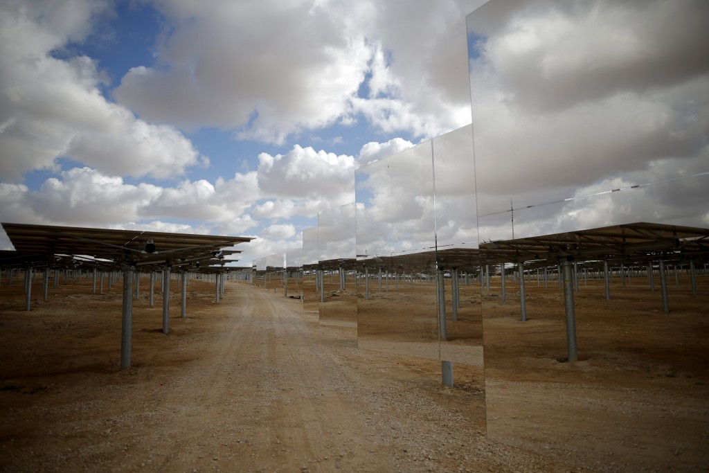 Heliostat mirrors reflect their surroundings in a field at the construction site of a 240 meter (787 feet) solar-power tower in Israel's southern Negev Desert, February 8, 2016. The world's tallest solar-power tower is being built off a highway in the Negev Desert in southern Israel, its backers hoping the technology will gain a foothold in the solar market even if it remains a small player for now. Picture taken February 8, 2016. REUTERS/Amir Cohen TPX IMAGES OF THE DAY